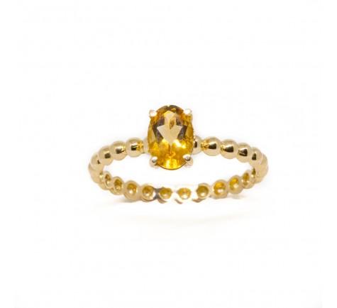 Sortija con piedra de color citríno semipreciosa en oro de 18K